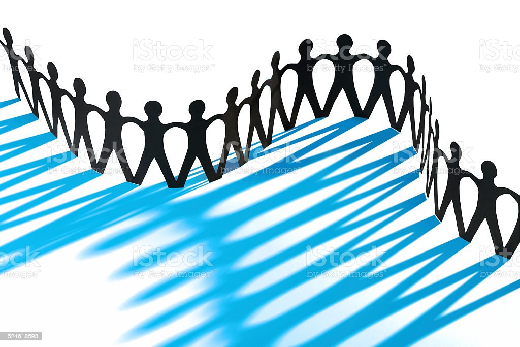 Cutout Men Joining Together As Team, Union, Family or Network stock photo