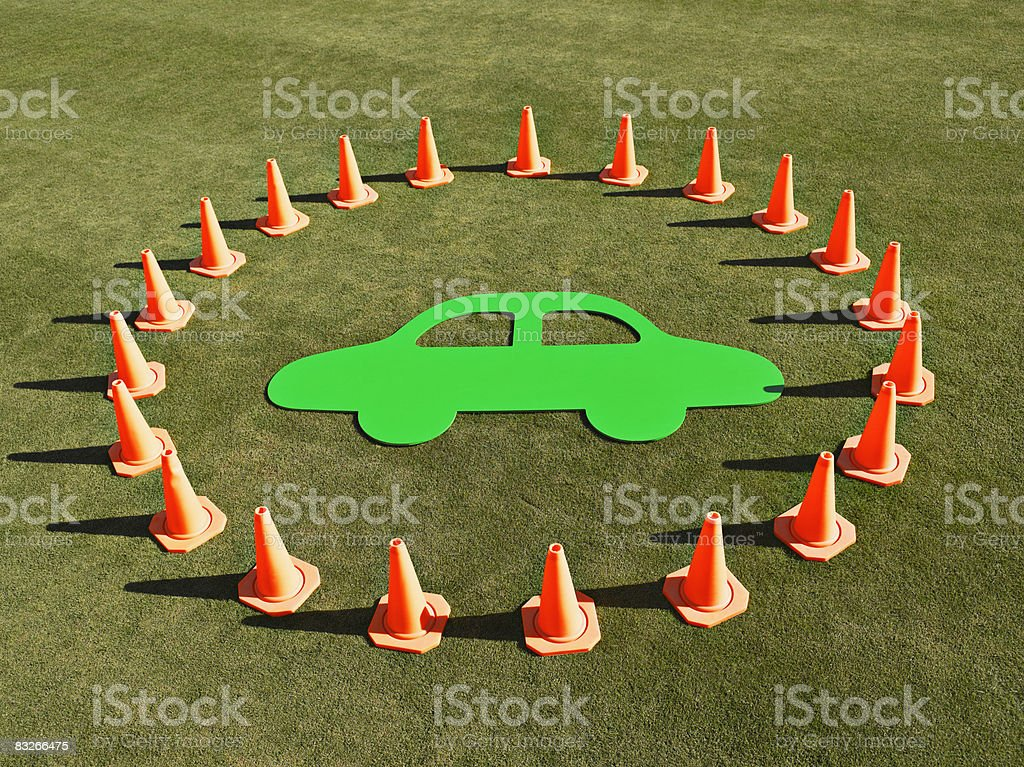 Cutout of car surrounded by traffic cones stock photo