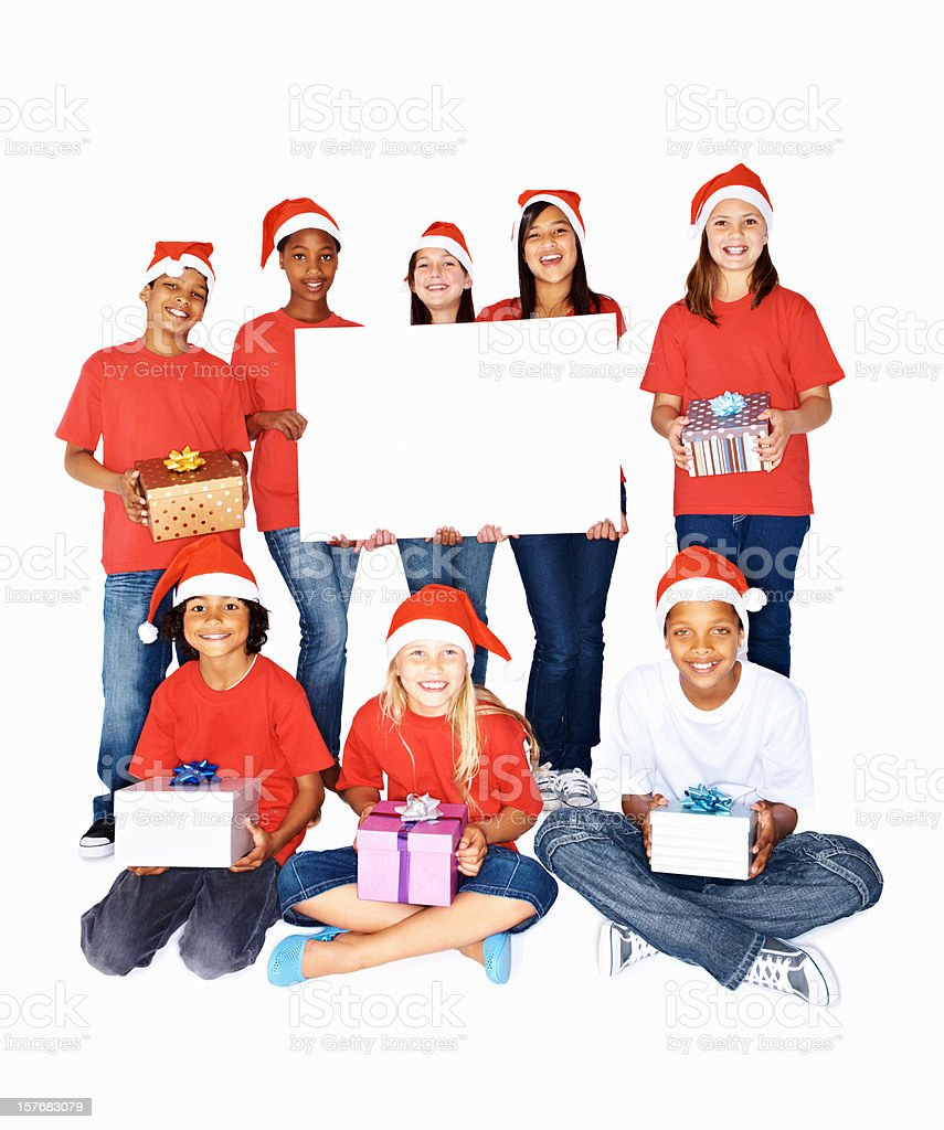Cutout of multi ethnic kids holding gifts and a billboard royalty-free stock photo