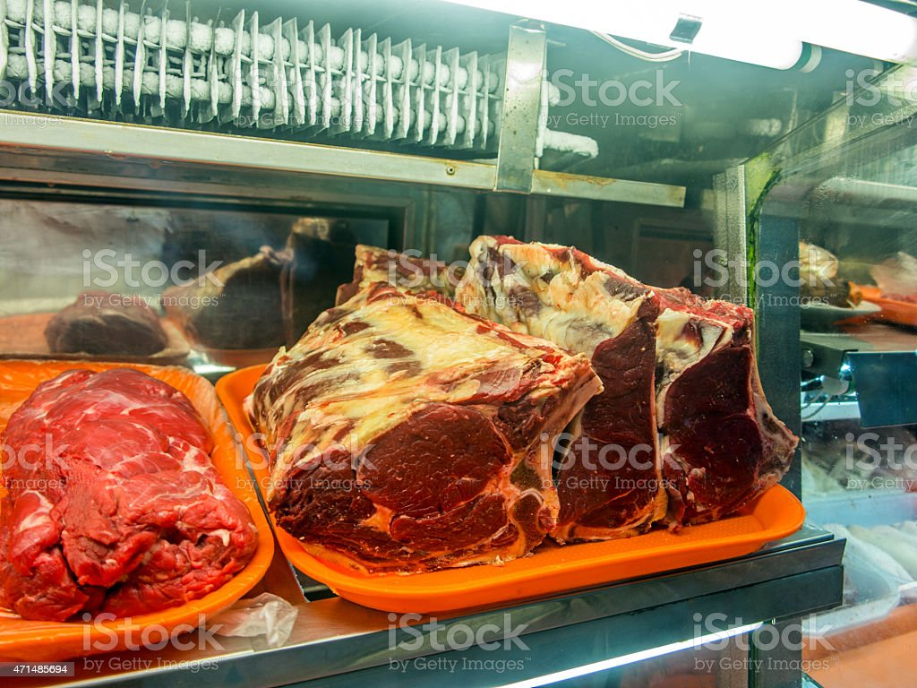 Cuts of meat at butchers in Peruvian market stock photo