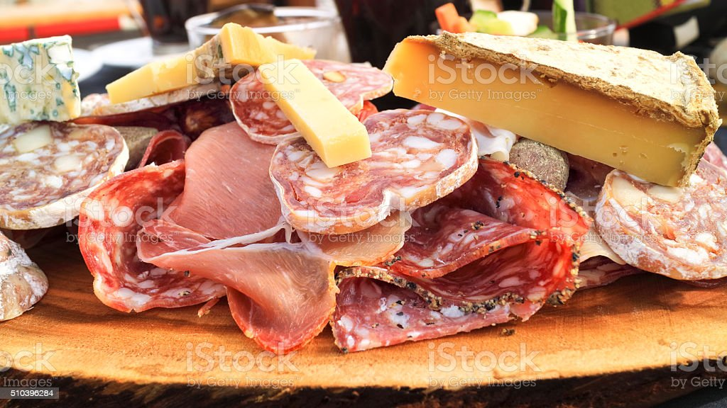 Cuts of red meat, cheese, ham, fatty sausage stock photo