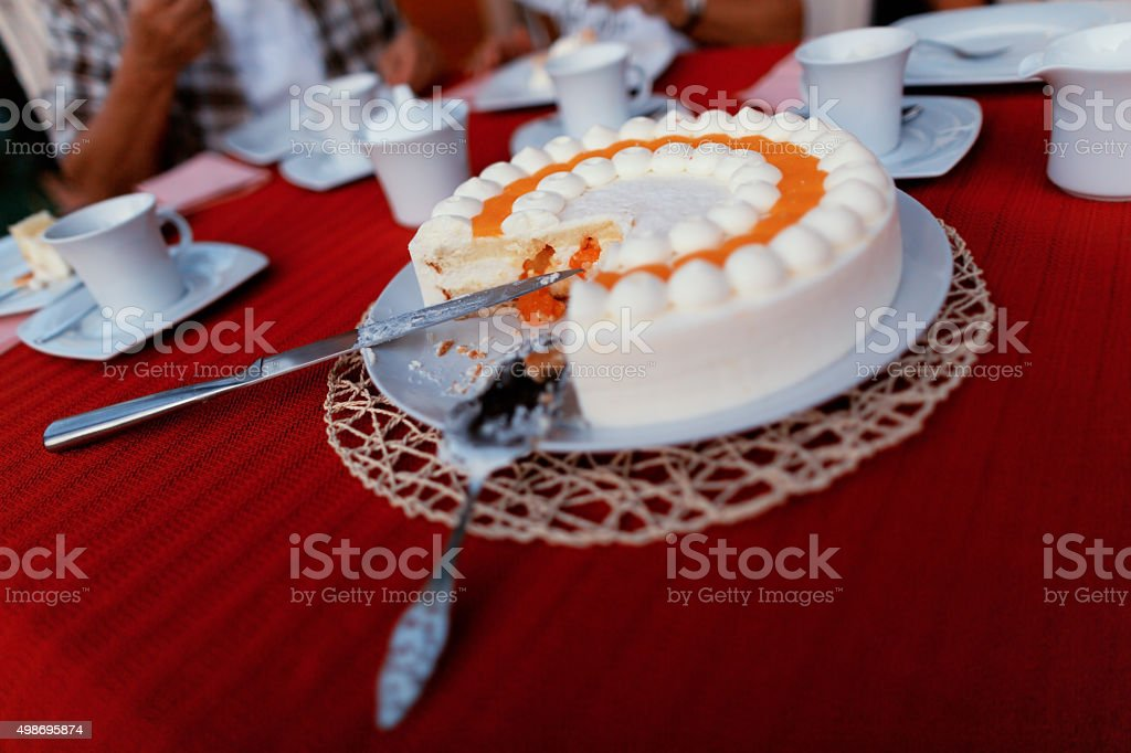 cutted cream cake on coffee table stock photo