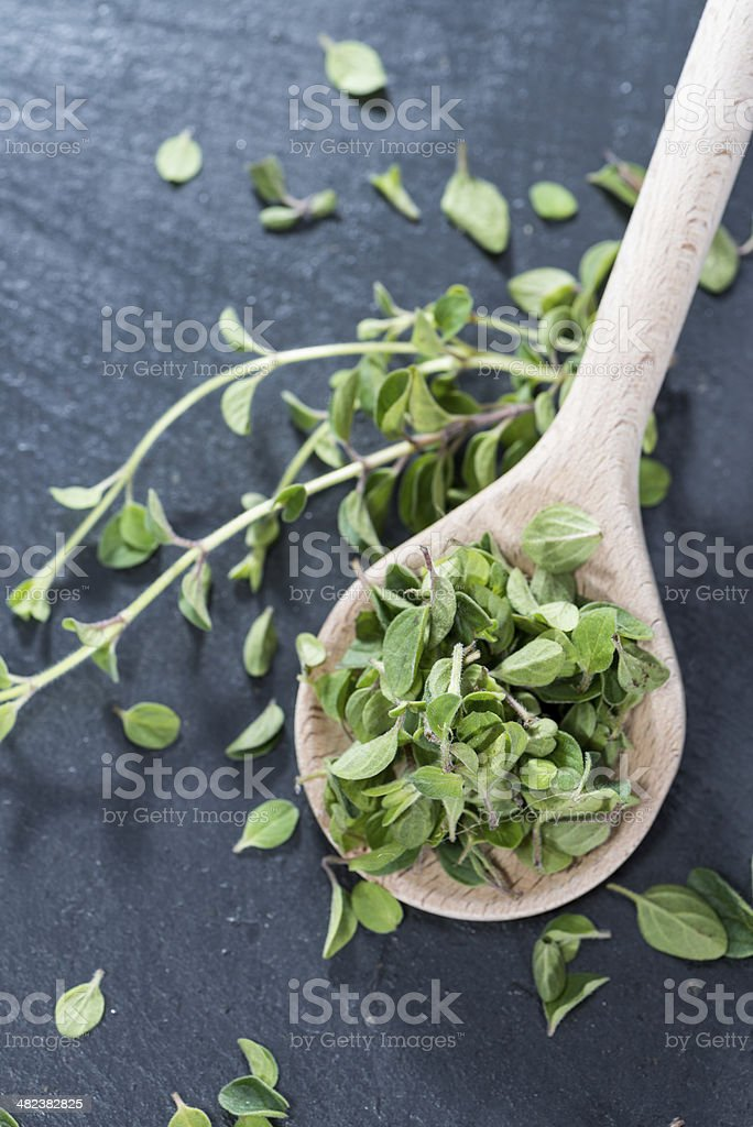 Cutted Oregano on a wooden spoon stock photo