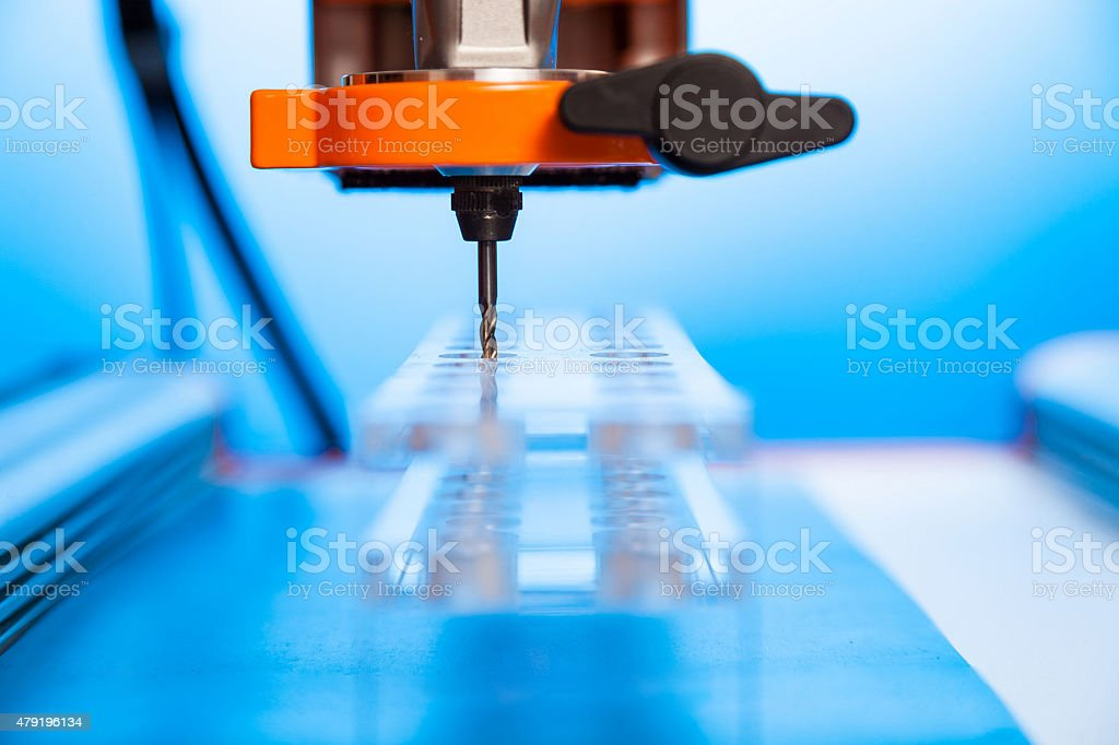 Cutter CNC router and plastic parts of Plexiglas stock photo