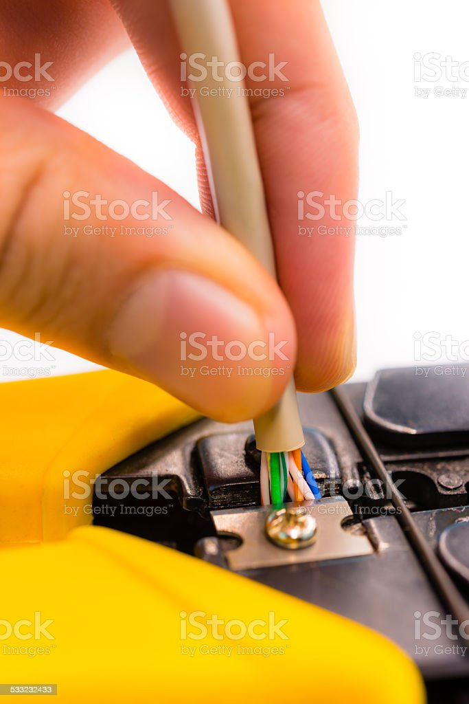 Cutter cutting a network cable isolated on white background stock photo