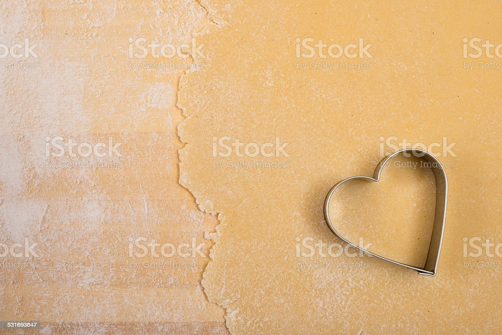 Cutter with dough and flour stock photo