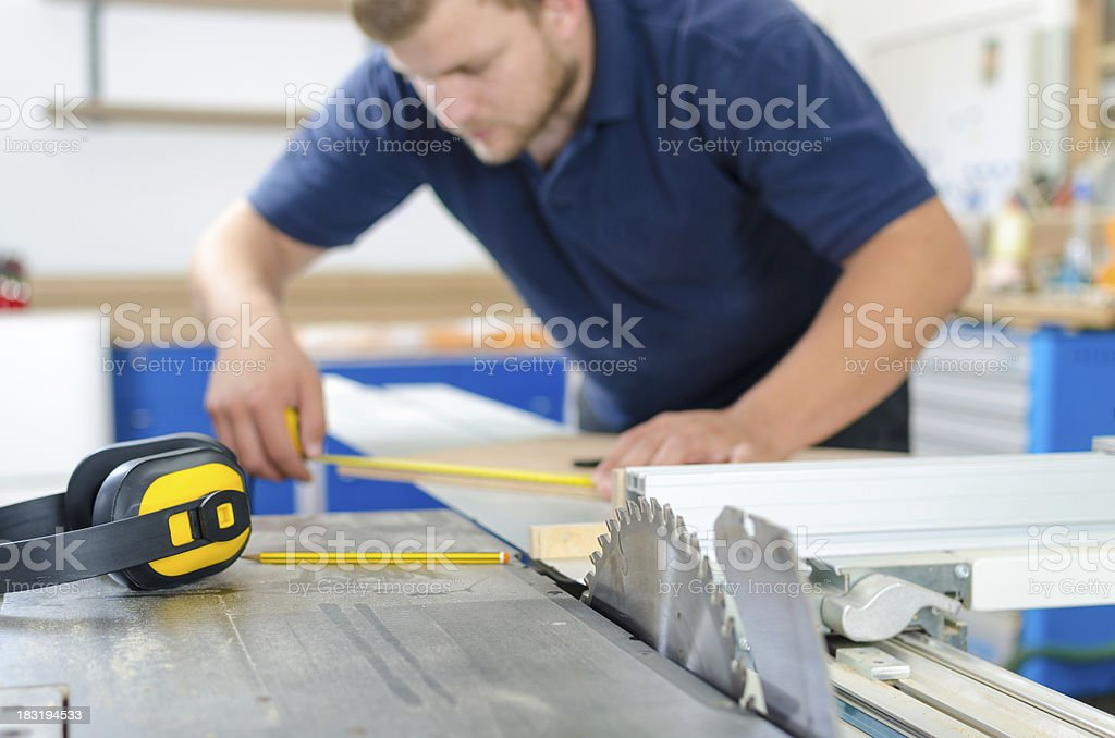 Cutting a Board royalty-free stock photo