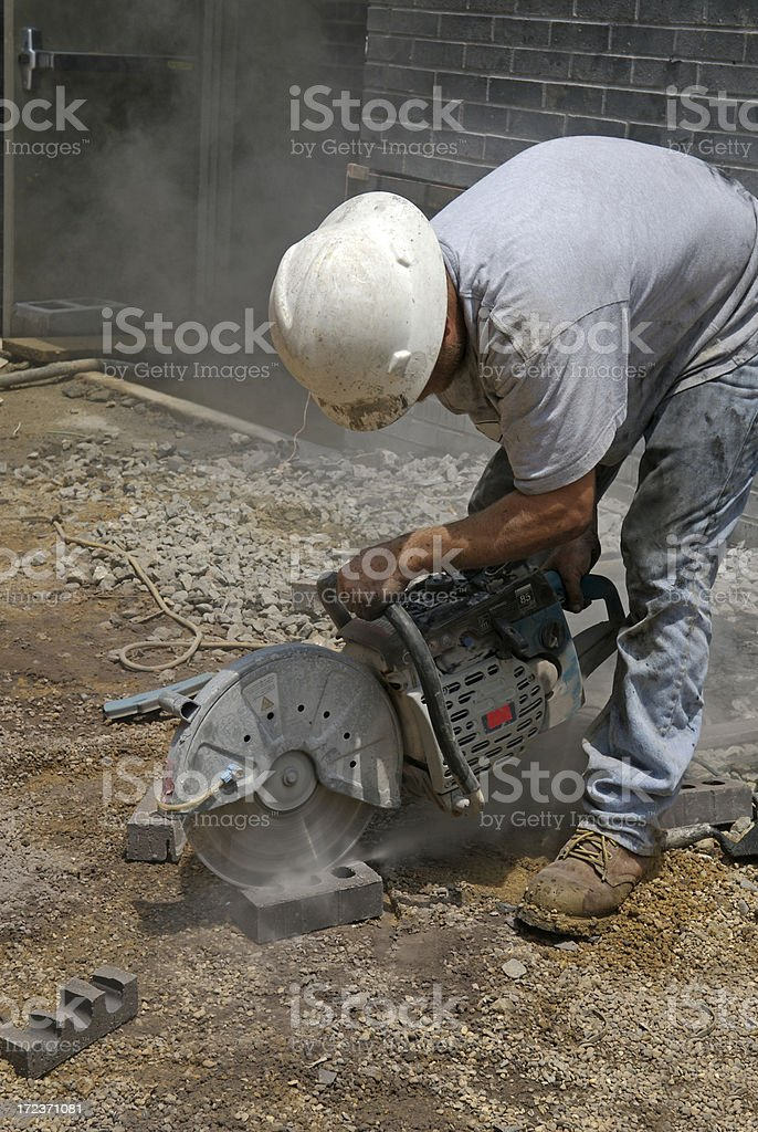 Cutting a Brick to Fit royalty-free stock photo