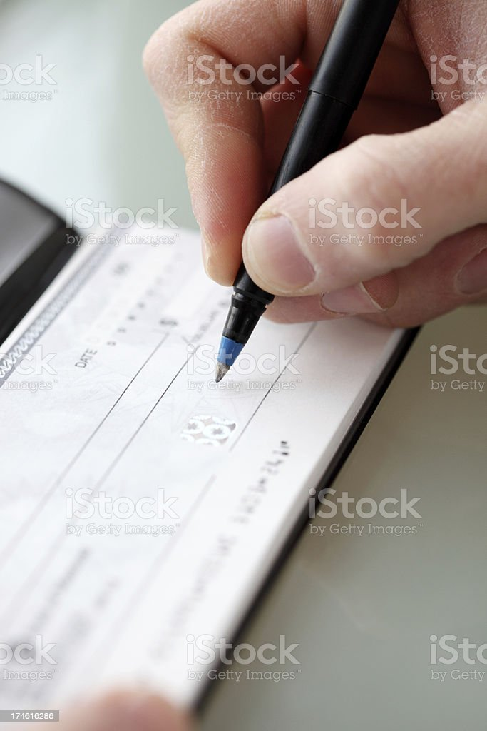 Cutting a Check stock photo