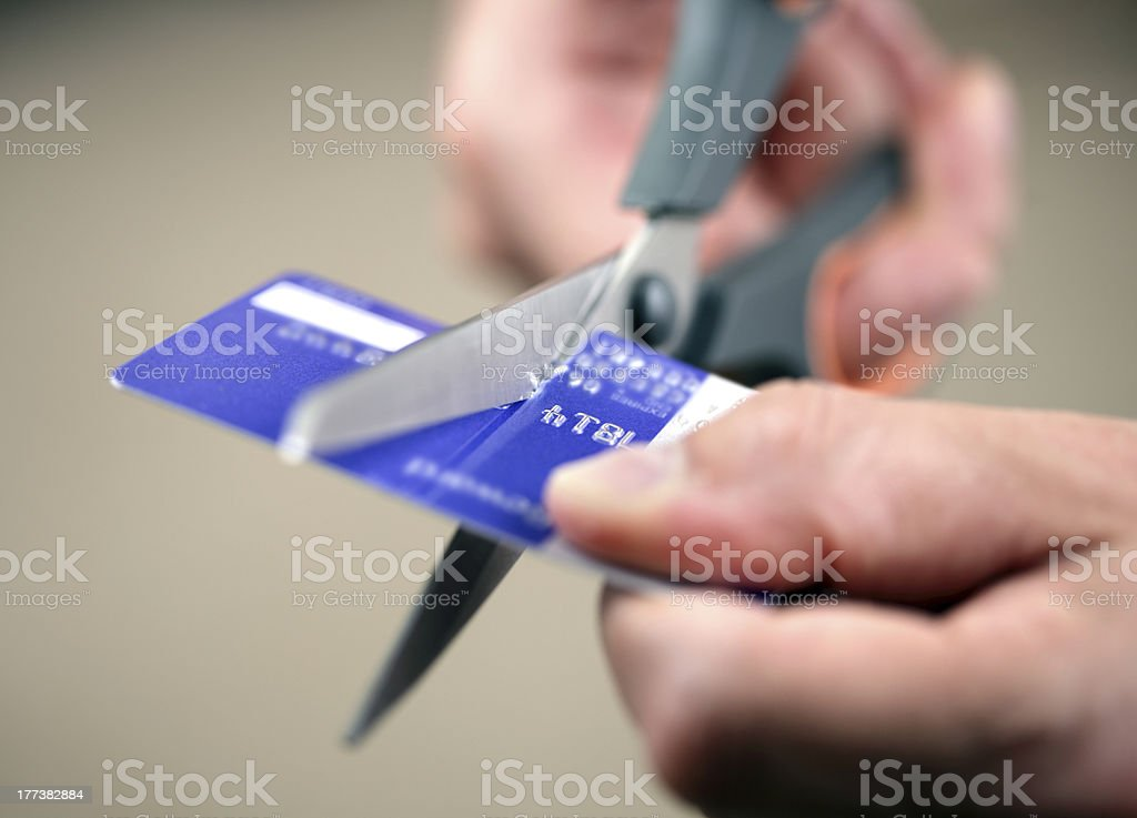 Cutting a credit card stock photo