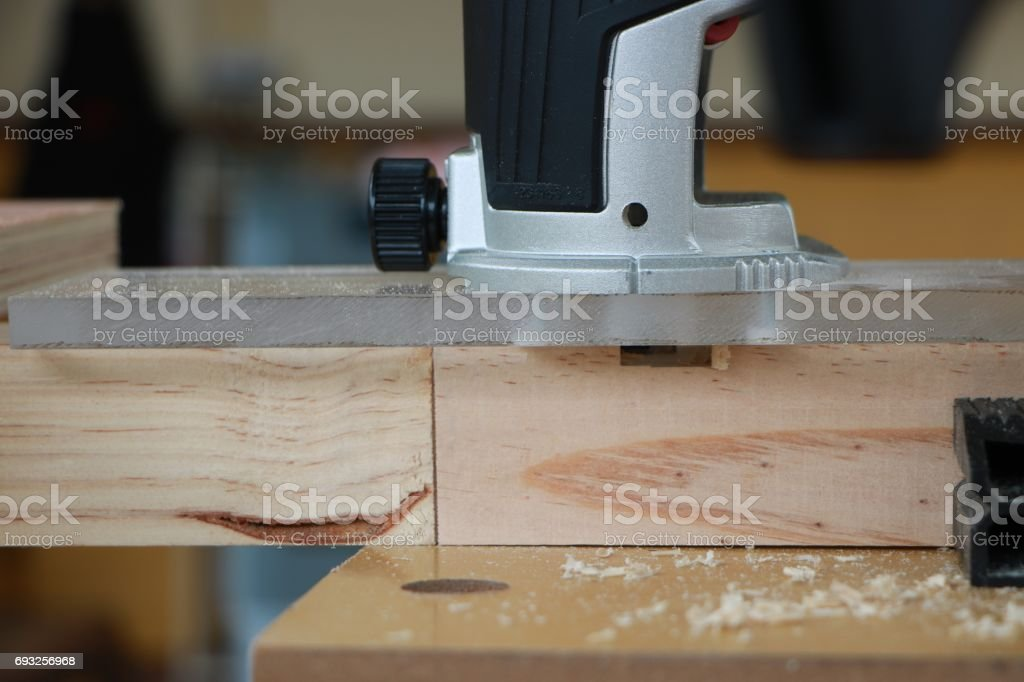 Cutting a mortise and tenon joint stock photo