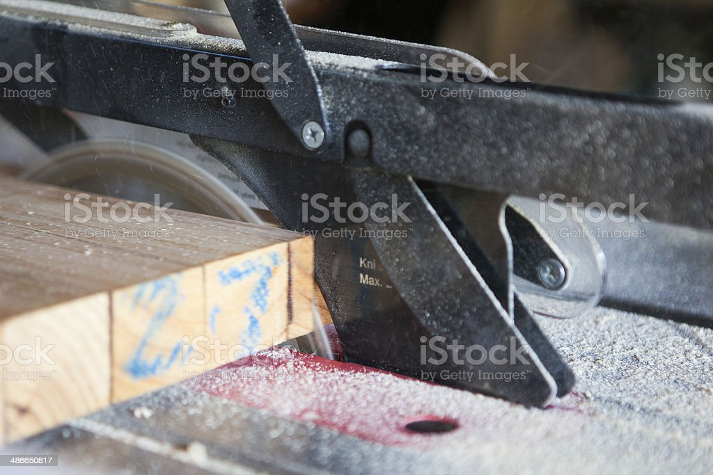 Cutting a plank with an electric saw stock photo