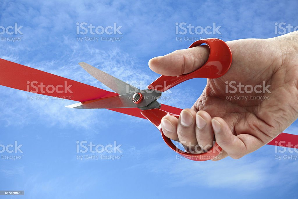 Cutting a red ribbon royalty-free stock photo