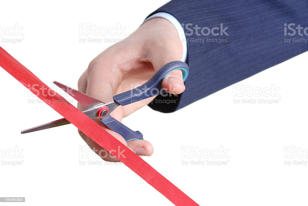 Cutting a red tape stock photo