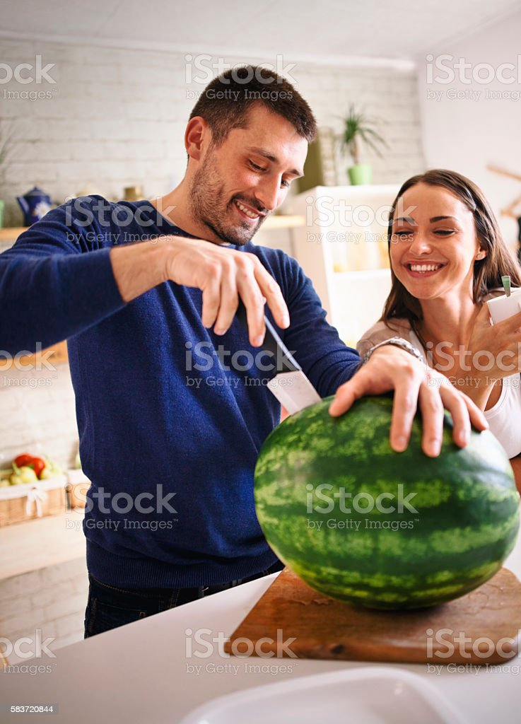 cutting a water melon stock photo