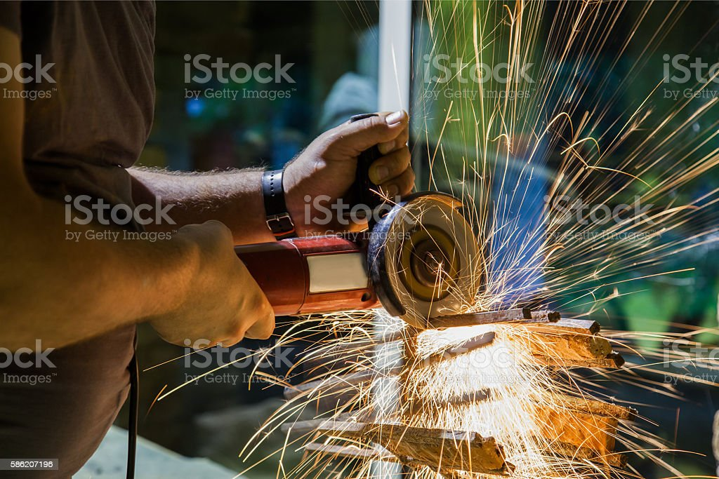 cutting and grinding metal construction stock photo