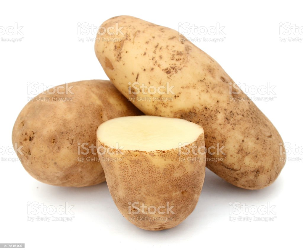 cutting and whole potatoes isolated stock photo