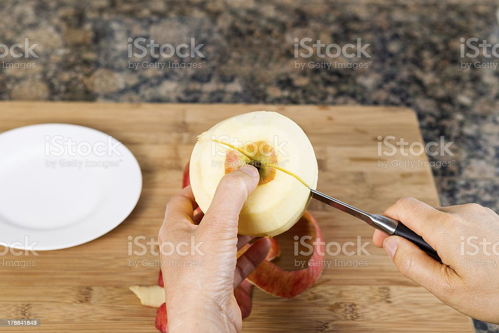 Cutting Apple in Half with Paring Knife stock photo