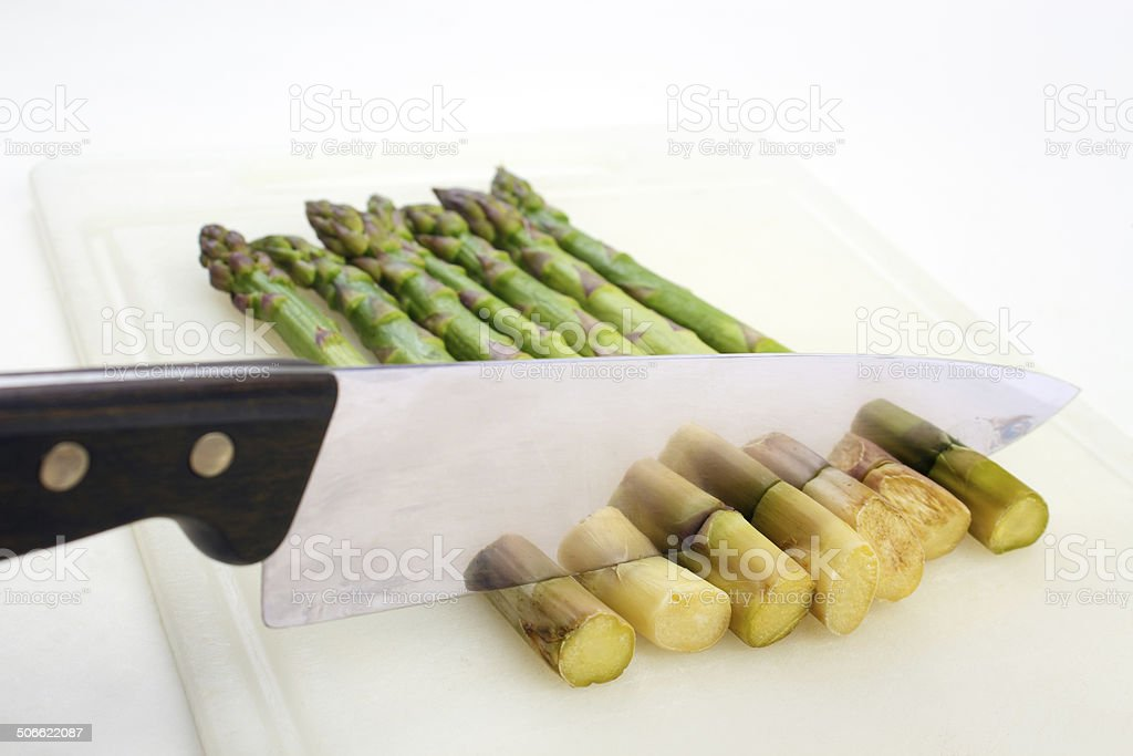 Cutting asparagus royalty-free stock photo