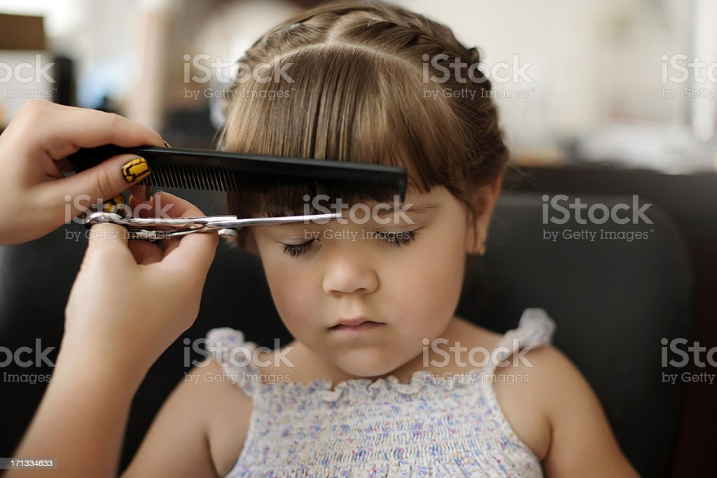 cutting bangs stock photo