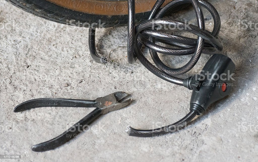 cutting bike lock with pliers stock photo