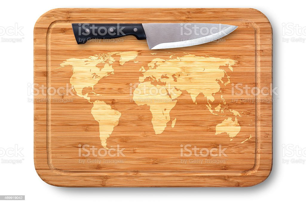 Cutting board and kitchen knife with world map stock photo