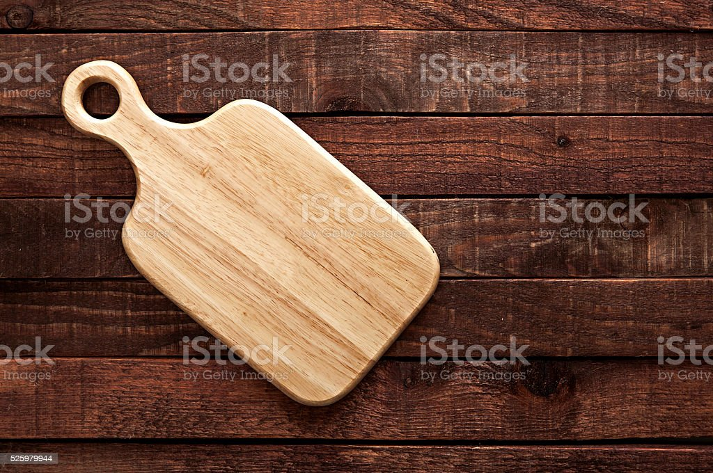 cutting board on a dark wooden table. top view
