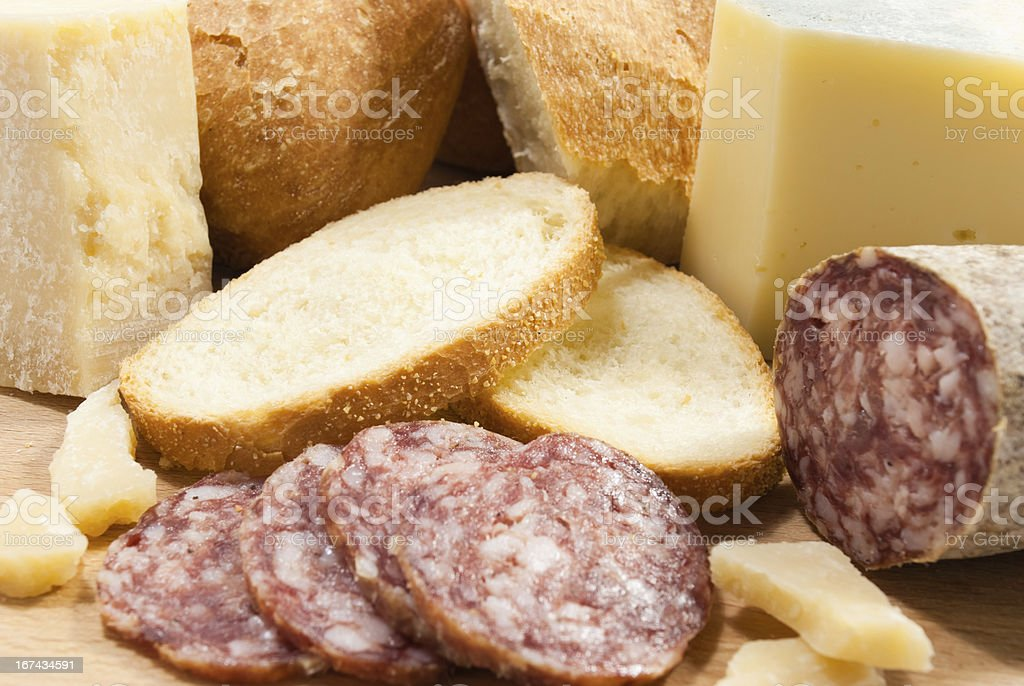 cutting board with bread, cheese and salami royalty-free stock photo