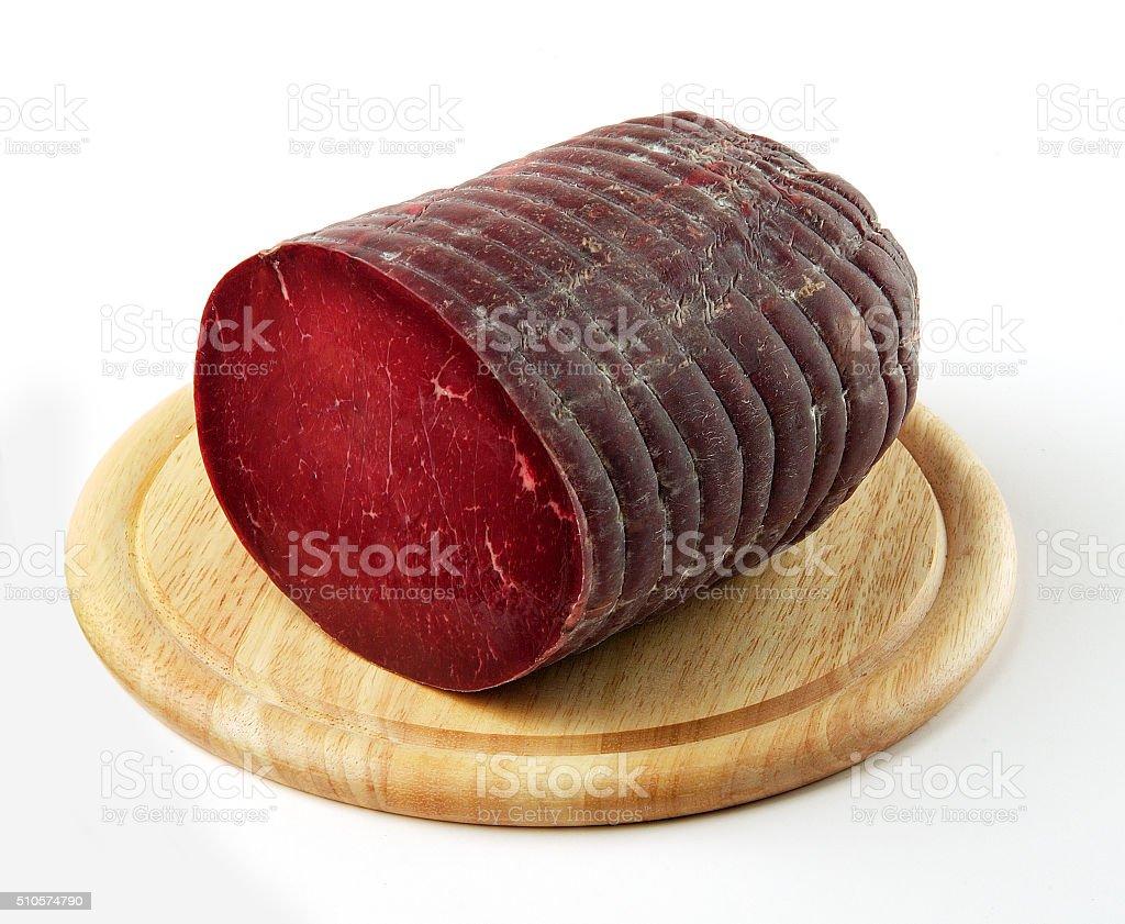Cutting board with Bresaola salami stock photo