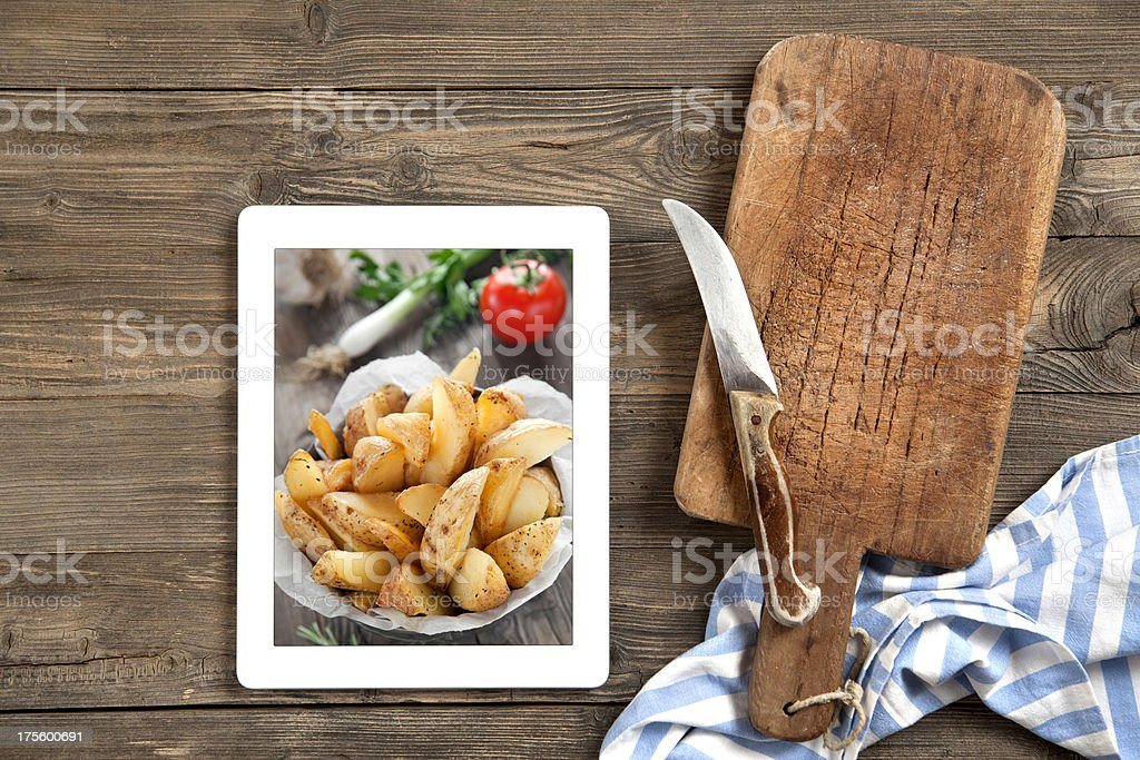 Cutting board with digital tablet stock photo