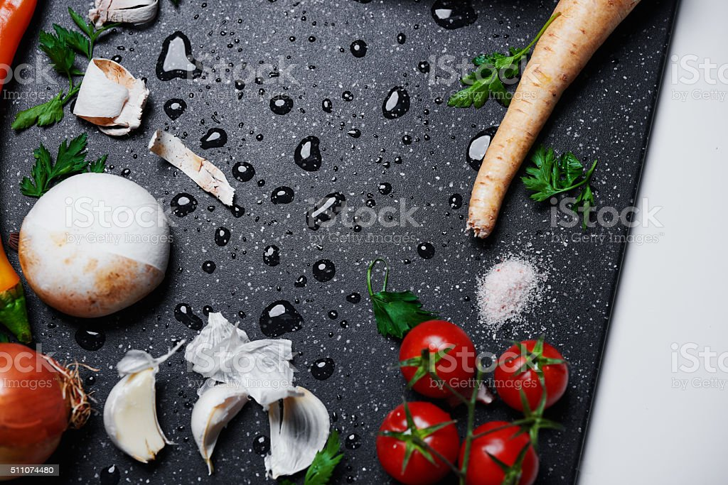cutting board with fresh vegetables stock photo