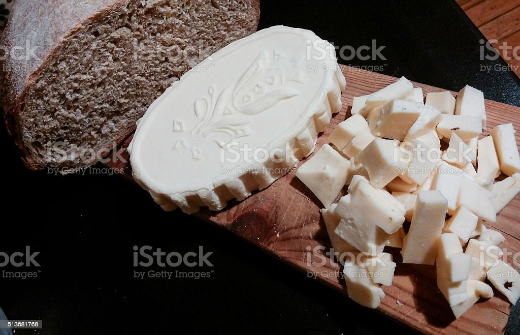 Cutting board with homemade butter, rye bread made with yeast royalty-free stock photo