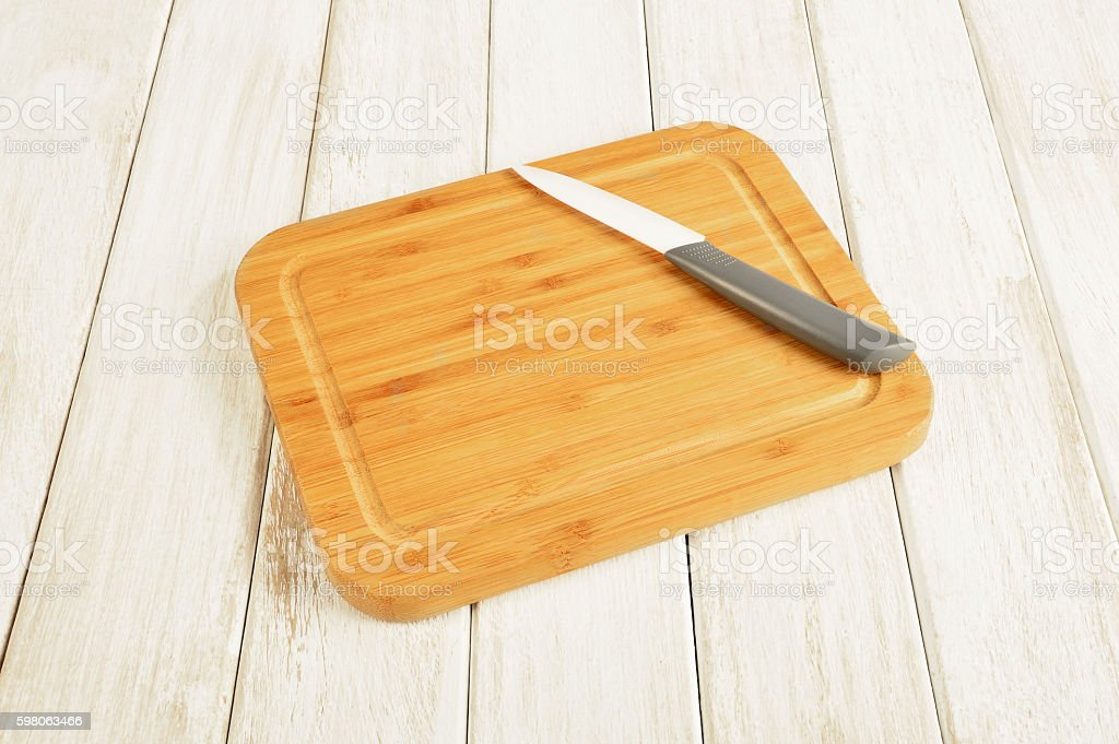 Cutting Board with Kitchen Knife stock photo