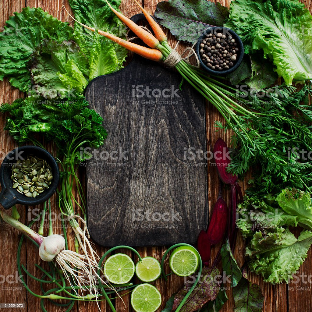 Cutting board with vegetables stock photo