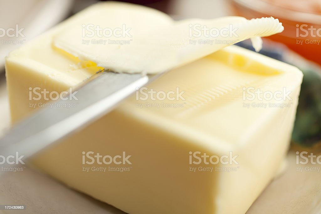 Cutting Butter royalty-free stock photo