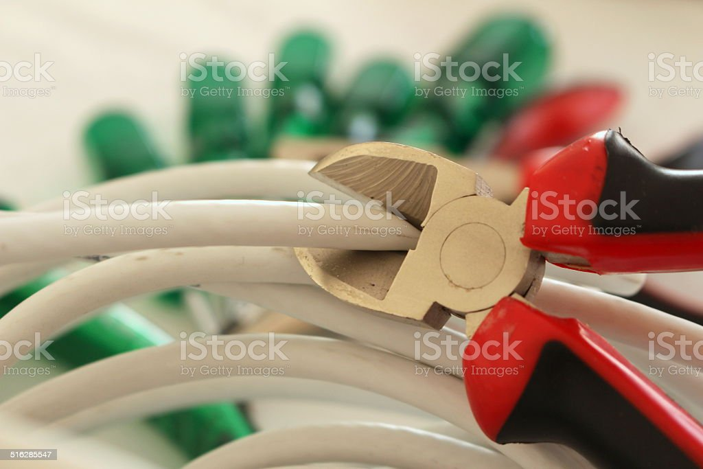 Cutting Cable With A Plier stock photo