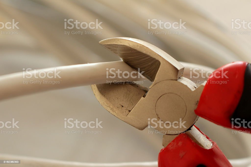 Cutting Cable with Plier stock photo