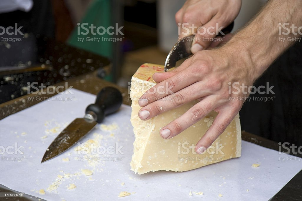 Cutting cheese royalty-free stock photo