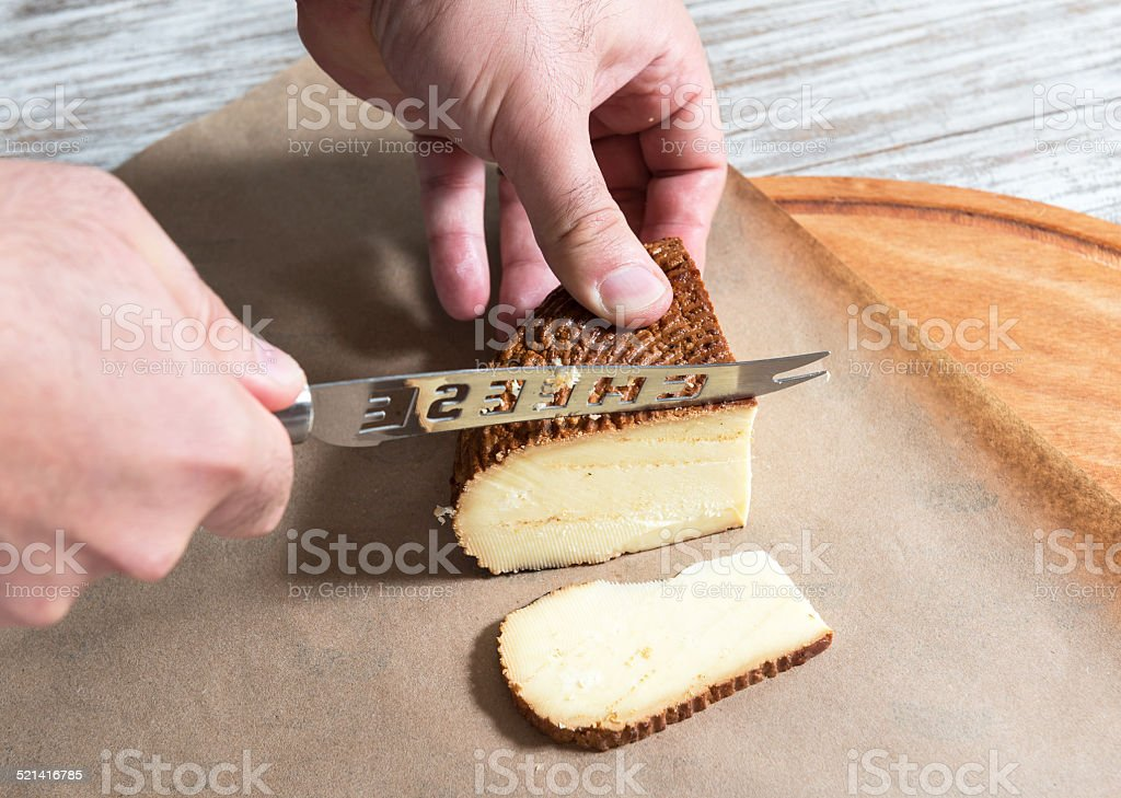 Cutting cheese stock photo