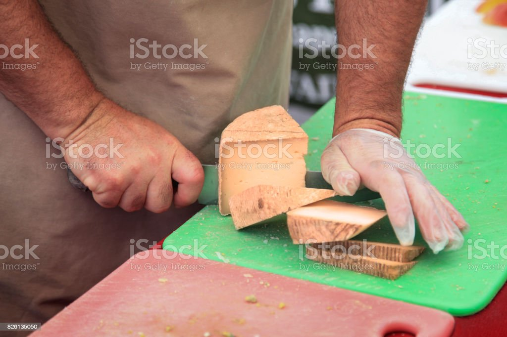 Cutting Cheese stock photo