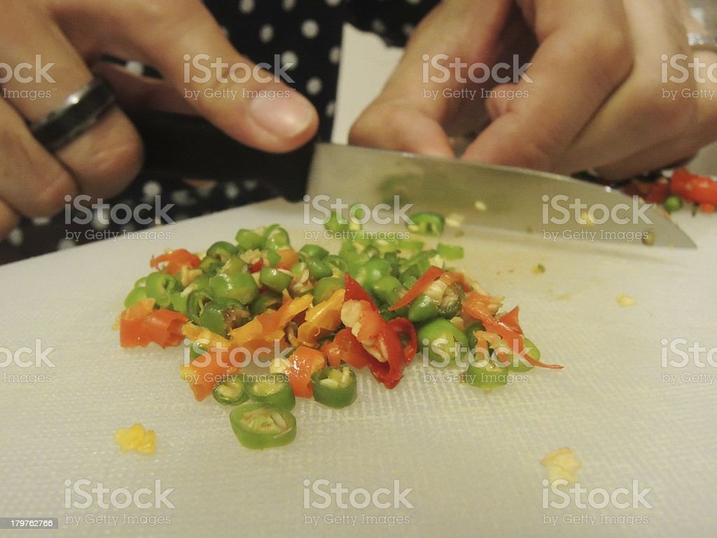 cutting chilli stock photo