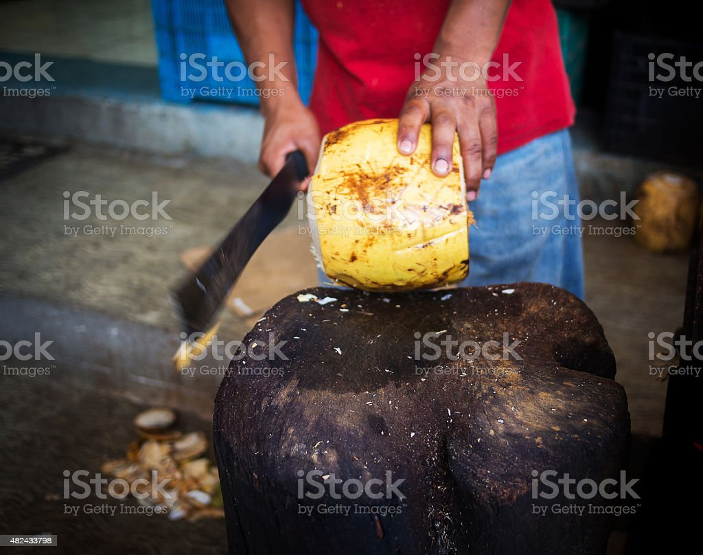 Cutting coconut stock photo