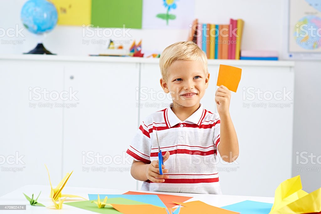 Cutting colorful paper stock photo