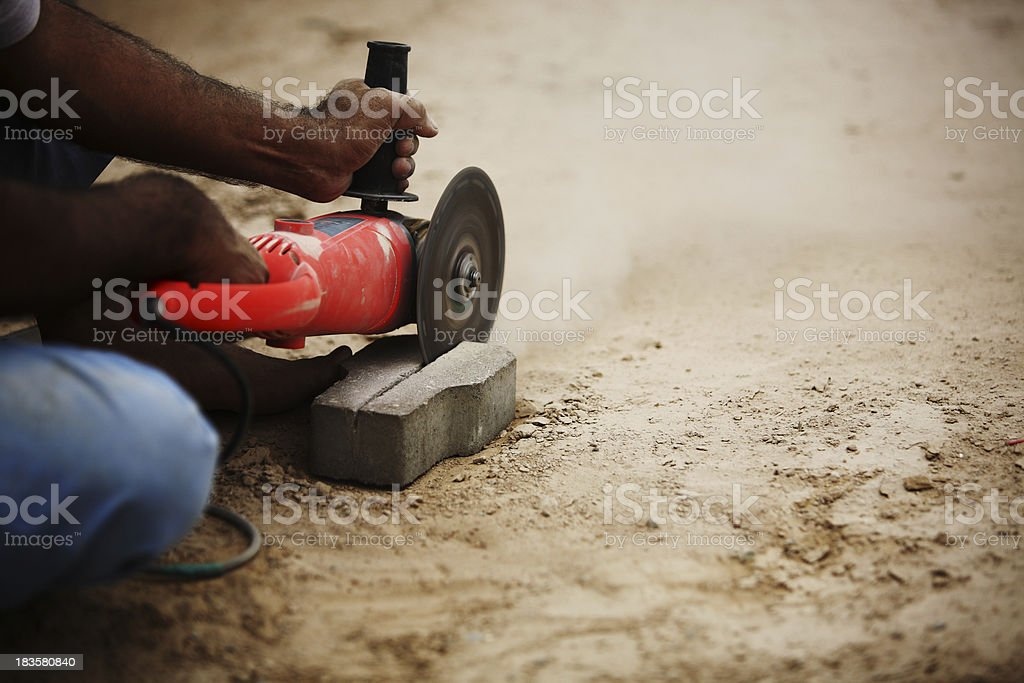 Cutting Concrete Pavement Kerbstone with Angle Power Disc Grinde stock photo