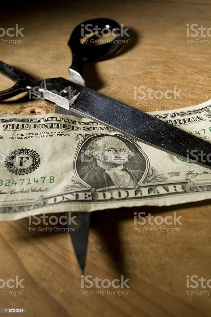 Cutting Costs royalty-free stock photo