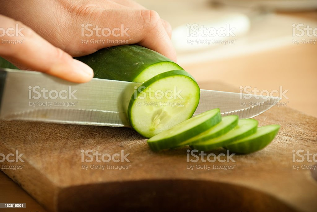 Cutting cucumber royalty-free stock photo