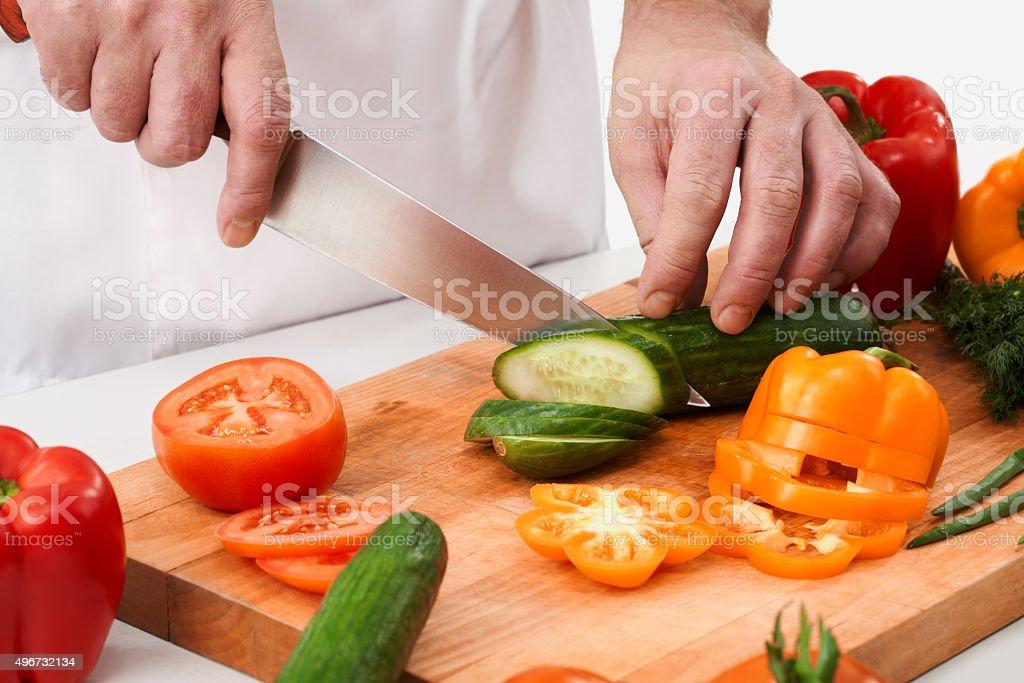 Cutting cucumbers stock photo