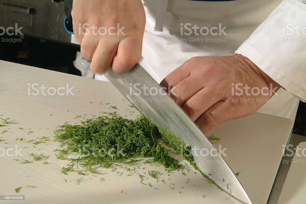Cutting dill leaves stock photo