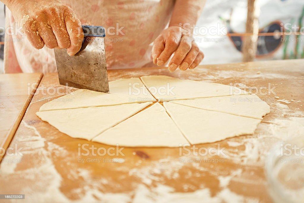 Cutting Dough royalty-free stock photo