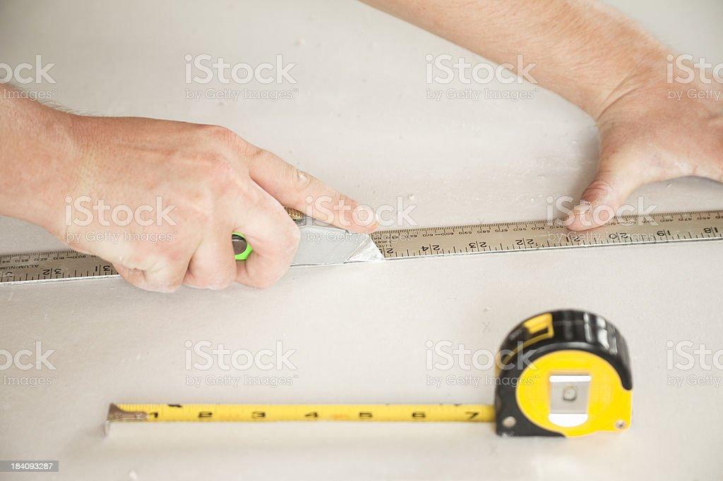 Cutting Drywall royalty-free stock photo